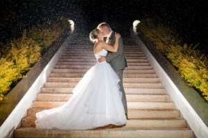 sweet home wedding, wedding bride and groom, ceremony, bride and groom kissing in the rain